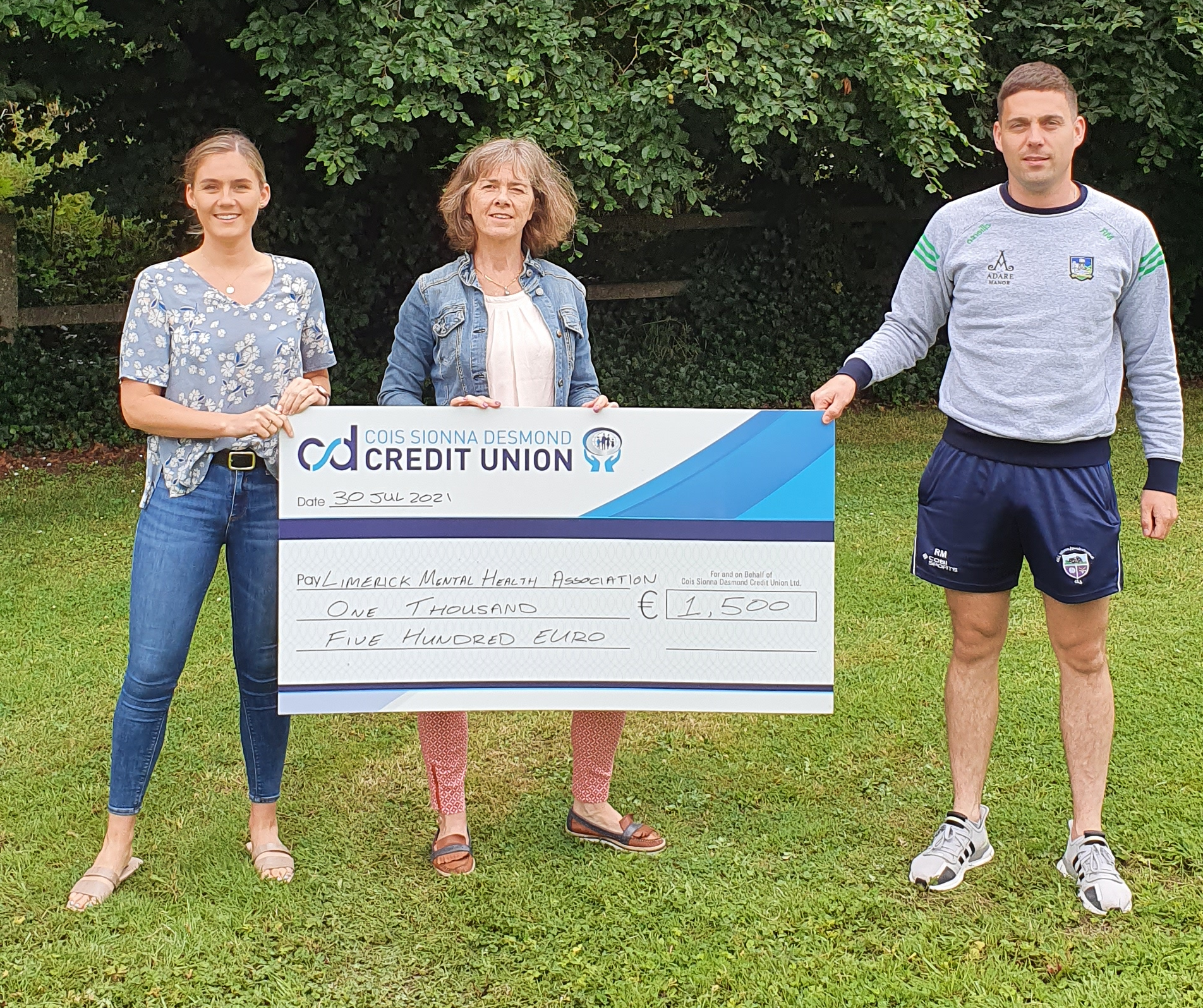 Curraghchase 10k presenting LMHA with a cheque for €1500 raised from the event